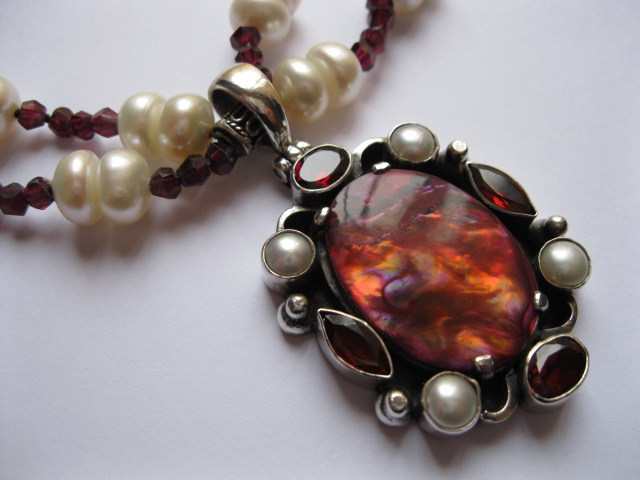 A Tudor Style Abalone Pendant Necklace with Garnets and Pearls in Sterling Silver.