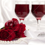stock-photo-15184192-roses-with-pearls-and-glasses-of-wine-on-white-satin